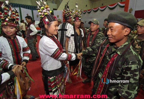 Member of HPC meet traditionally dressed dancers during the arms laying down ceremony at Guwahati